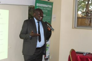 The Guest speaker of the '4th National Organic Innovation & Research Dissemination Symposium' , Mr. Paul Mwambu (Commissioner Crop Inspection & Certification)